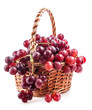 Red grape in a wicker basket, isolated on white background