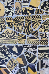 Details of a colorful ceramic bench at Parc Guell designed by An