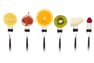 Fruits slices on forks.
