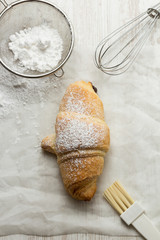 Making croissant, with kitchen utensils