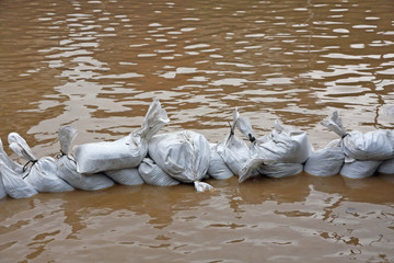 wall of sandbags to fend off raging river