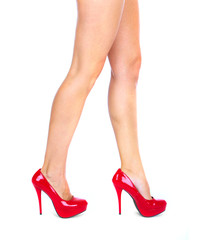 Woman legs with a red sexy shoes.