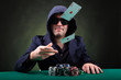Poker player throwing two ace cards on black background