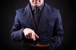 Business man holding a digital tablet on black background