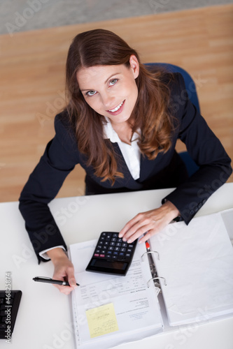 Smiling accountant sitting at her desk working