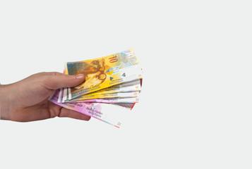 hand haltend Schweizer Franken