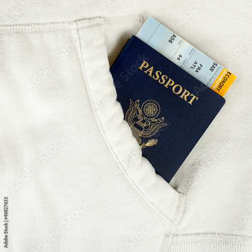 passport and boarding pass in white pocket