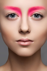 Beautiful model with creative bright makeup like a doll