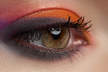 Close-up of female eye with bright multicolored eyeshadow