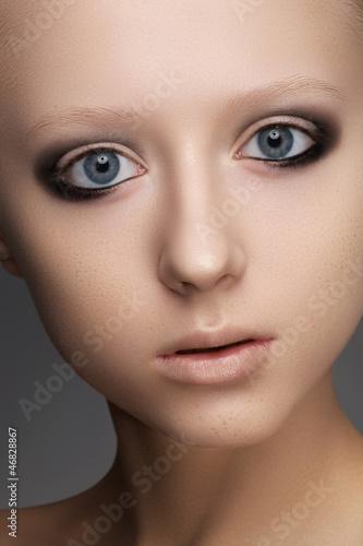 Dark brown smoky eyes makeup and beige lips make-up