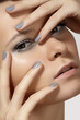 Glamour model face with silver make-up & manicure