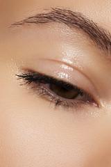 Eye with natural makeup. Moisturizing gel on eyelid