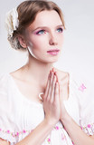 Devotion. Faith. Young christian woman praying against her sin