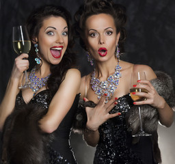 Couple of women celebrating birthday in restaurant. Holidays
