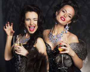 Young women in black elegant dress with champagne - nightlife