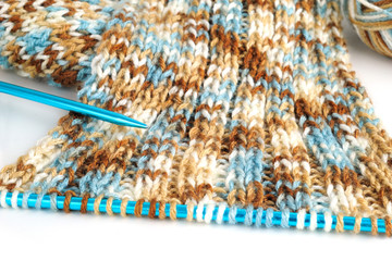 Knitting Skein and Blue Needles