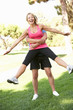 Senior Man Lifting Woman During excercise,fitness, In Park