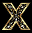 X gold letter with swirly ornaments