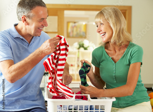Senior Couple Sorting Laundry Together