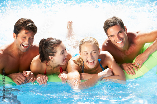 Group Of Friends Having Fun In Swimming Pool