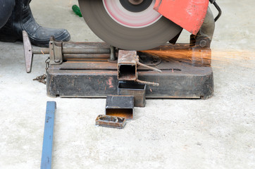 Steel with machine for cutting steel.