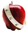 Measuring tape wrapped around apple