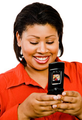 Happy woman text messaging