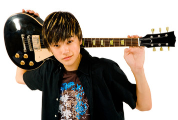 Portrait of teenage boy holding guitar