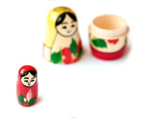 Matrioshka doll on white background.
