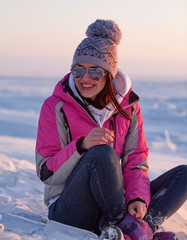 Young woman relaxing on snow