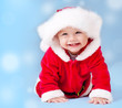 Sweet baby wearing Santa costume