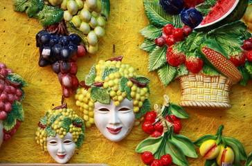 Bacchus masks and fruit decorations