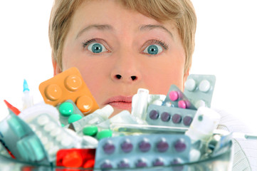 woman with a lot of medicine to take