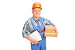 A male worker in uniform holding boxes and clipboard