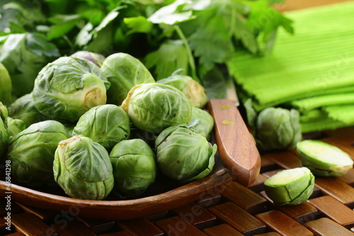 fresh raw brussels sprouts on a wooden table