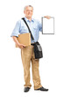 Delivery person holding a clipboard and box