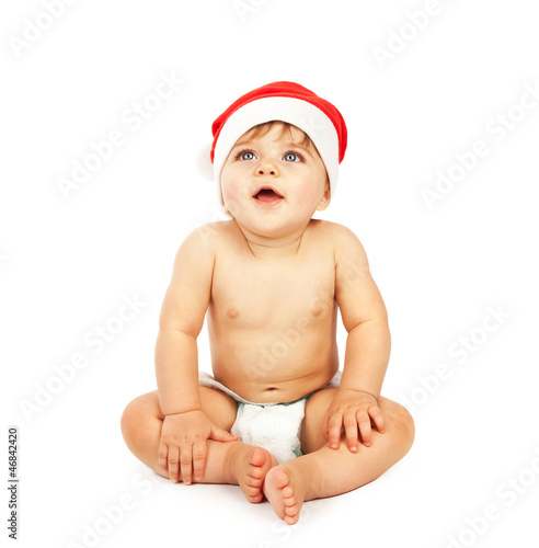 Baby boy wearing christmas hat