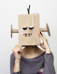 Woman with a cardboard box on his head.