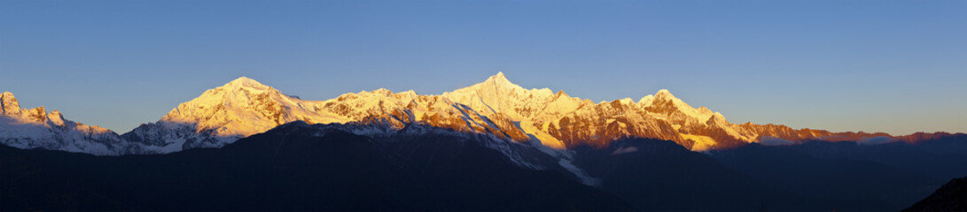 Sunrise on snow mountains in China