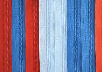 background in the form of zippers for clothes