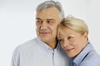 Portrait of cheerful senior couple at home