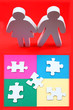 Male and female figures standing in front of puzzle pieces