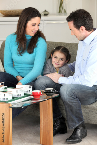 Family looking at a new-build model