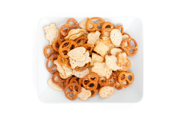 pretzels on a plate isolated on a white background