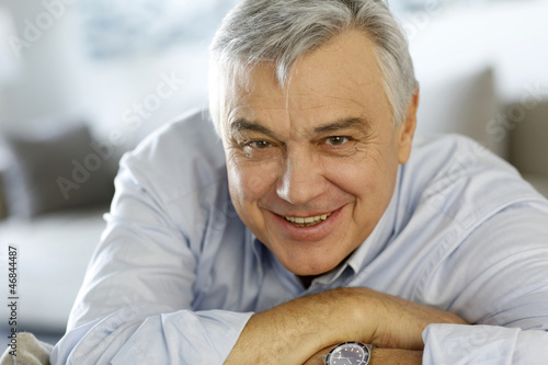 Portrait of senior man relaxing in sofa at home