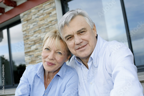 Cheerful senior couple looking at camera