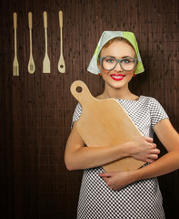 Close-up of a rural funny woman cook with kitchen cutting board