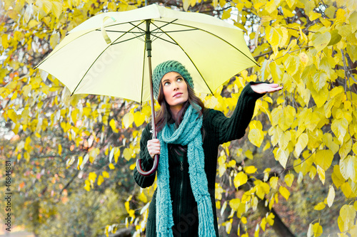 beautiful young girl under yellow umbrella
