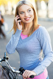 Woman on bike with mobile phone