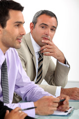 Two men sat on interview panel